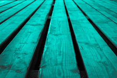 Rough turquoise grayish grayscale wooden stage background with l Royalty Free Stock Images