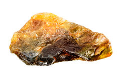 Rough uncut yellow orange sapphire Royalty Free Stock Photo