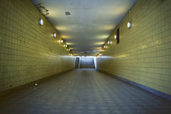 Rough underground passage for pedestrians. stock photo