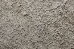 Rough unpainted concrete wall. Stock Image