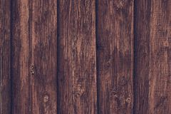 Rough unpolished wooden dark boards. Vintage oak table. Old brown wooden fence. Wood old plank vintage texture background. Rough unpolished wooden dark boards stock photos