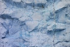 A rough untreated surface is a natural stone surface. The texture of the natural rock is the background. Granite or cracked marble.  Stock Photos
