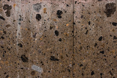 Rough wall granite tiles with different color spots background texture Stock Images