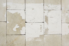 Rough wall tiles with old white paint background texture Royalty Free Stock Images