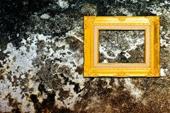 Rough wall with vintage gold frame Royalty Free Stock Photo