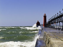 Rough Water at the Lighthouse. A very windy day on Lake Michigan at the Grand Haven Lighthouse and Pier Royalty Free Stock Photo