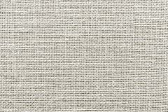 Rough wattled sackcloth texture of pale color Stock Images