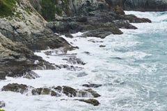 Rough waves on a coast Stock Photos