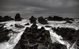 Rough waves crashing against coastline. Wild sea on the coast of New Zealand before it started heavy to rain Stock Image