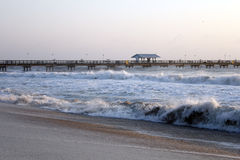 Stormy Seas in Florida. Rough waves pound the coast of Lauderdale by the Sea, Florida a few days after Hurricane Sandy passed by the area closing Anglers Pier royalty free stock photos