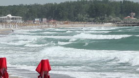 Rough Waves on Shore. Rough sea and big foamy green waves at the beach, on a windy summer day stock video footage