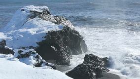 Rough waves splash at volcanic rocks in the Atlantic Ocean stock video footage