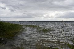 Rough weather on Lake Plauer See on midday stock photos
