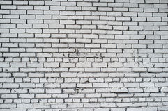 Rough white brick wall. Lit by the sun's rays directed from left stock photo