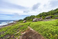 Rough and wild rocky coastline at anse songe, la digue, seychell Royalty Free Stock Image