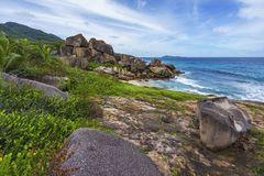 Rough and wild rocky coastline at anse songe, la digue, seychell Royalty Free Stock Photos