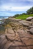 Rough and wild rocky coastline at anse songe, la digue, seychell Stock Images
