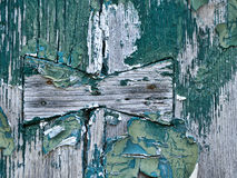 Rough wood background with peeling paint etc. Royalty Free Stock Images