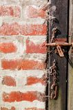 Rough wood door and brick wall. Old rough wood door and brick wall background texture Stock Photo
