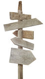 Rough wood signs on post. Rough hewn wood signs pointing in various directions Stock Image