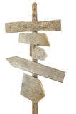 Rough wood signs on post. Rough hewn wood signs pointing in various directions stock photo