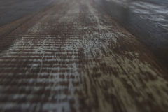 Rough wood table surface in perspective view. Great for backgrounds. Royalty Free Stock Photo