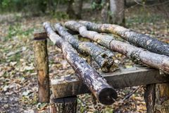 Bench in forest. A rough wooden bench in the forest Stock Photos