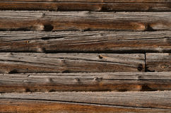 Rough wooden boards brown, arranged horizontally side by side Royalty Free Stock Photo