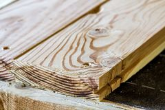 Rough wooden brown plank boards floor installation. Wooden mater. Ial texture surface. Building, repairing, handwork Royalty Free Stock Photos