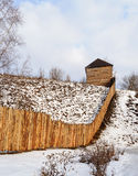 Rough wooden fence on the hill in winter time Royalty Free Stock Images