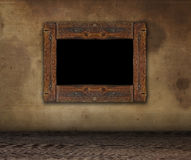 Rough wooden frame for painting grunge. Dirty wall with frame. Royalty Free Stock Photos
