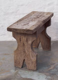 Rough wooden stool. Little wooden stool for feet Royalty Free Stock Photo