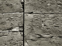 Rough wooden surface wallpaper. Old black and white wood rough surface - nice background pattern with cracks and crevices Stock Images