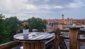 Rough wooden table, on the background of St. Petersburg, in a rooftop cafe on a rainy day. Summer 2016. Royalty Free Stock Image