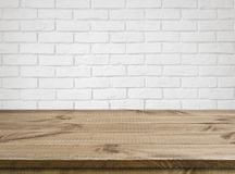 Rough wooden texture table over defocused white brick wall background.  Royalty Free Stock Photography