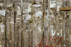 Rough worn out fence with torn off posters Stock Photo