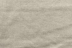 Rough woven texture fabric of beige color Stock Images