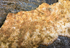 Rough yellow golden rock surface Stock Photo