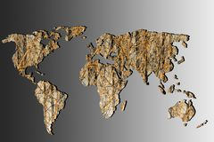 Roughly outlined world map with dry Autumn leaves  filling. Roughly outlined world map with a gray background royalty free stock images