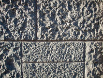 Roughly Textured Stone Wall Royalty Free Stock Photography