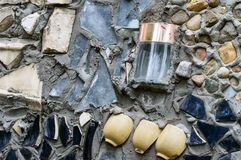 Roughly uneven background. glass and ceramics in the wall Stock Photo