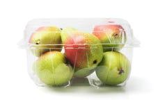 Rougissent les poires dans le récipient en plastique Images stock