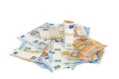 Roulé vers le haut d'euro billets de banque winded enveloppés Photo stock