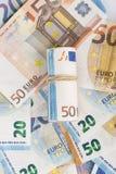 Roulé vers le haut d'euro billets de banque winded enveloppés Photos libres de droits