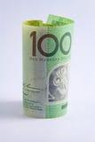 Roulé vers le haut de l'Australien la note des 100 dollars Photos stock