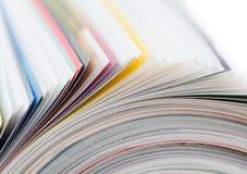 Roulé vers le haut de la revue Photographie stock libre de droits