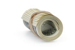Roulé cent billets de banque du dollar attachés avec Photos stock