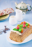 Roulade cake, decorated with colourful buttercream flowers Stock Photography