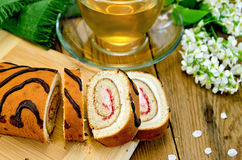 Roulade with cream and jam on the board Stock Photography