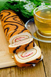 Roulade with a cup of tea on board Royalty Free Stock Photos